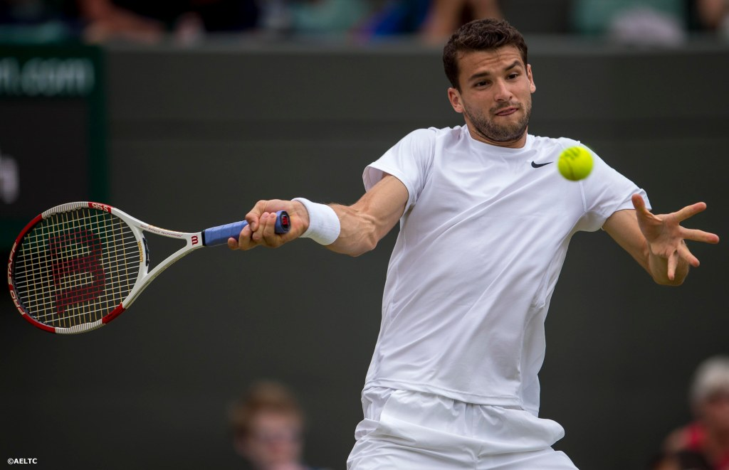 """Grigor Dimitrov hits a forehand during a match against Aleandr Dolgopolov at the All England Lawn and Tennis Club in London, England Friday, June 27, 2014 during the 2014 Championships Wimbledon."""