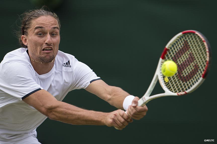 """Alexandr Dolgopolov hits a backhand during a match against Grigor Dimitrov at the All England Lawn and Tennis Club in London, England Friday, June 27, 2014 during the 2014 Championships Wimbledon."""