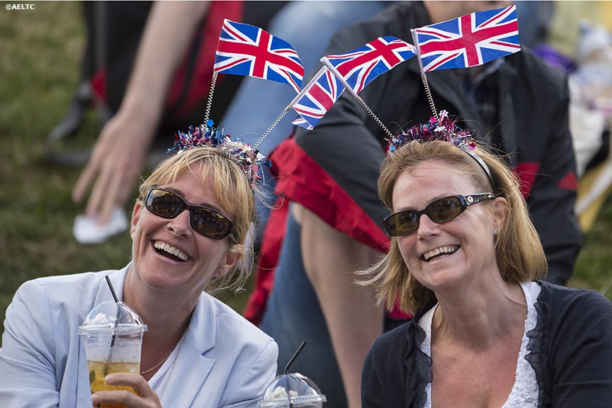 """Fans wear British flags on their heads as they watch a match on Henman Hill at the All England Lawn and Tennis Club in London, England Friday, June 27, 2014 during the 2014 Championships Wimbledon."""