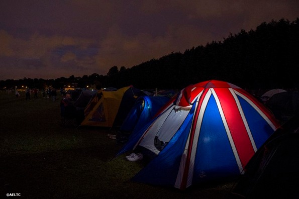 """""""A tent with a British flag design is shown at night in the queue at the All England Lawn and Tennis Club in London, England Saturday, June 28, 2014 during the 2014 Championships Wimbledon."""""""