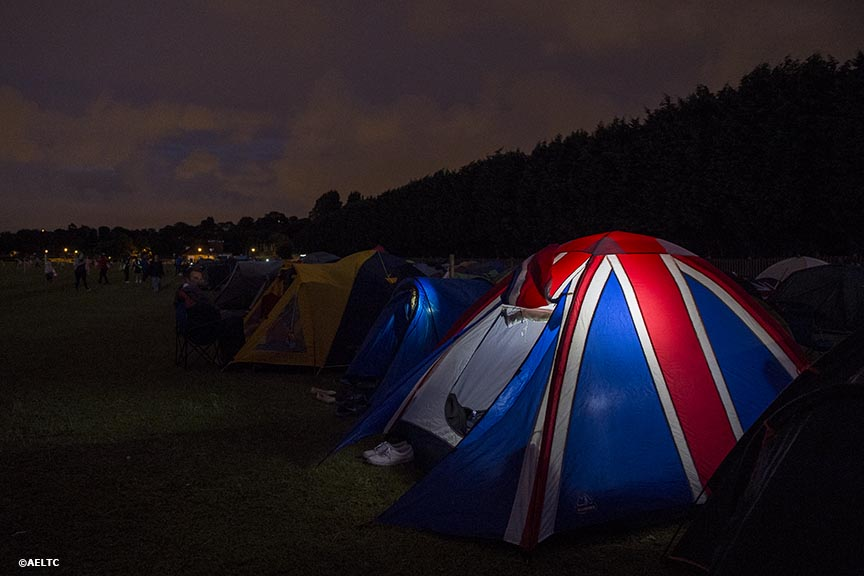 """A tent with a British flag design is shown at night in the queue at the All England Lawn and Tennis Club in London, England Saturday, June 28, 2014 during the 2014 Championships Wimbledon."""