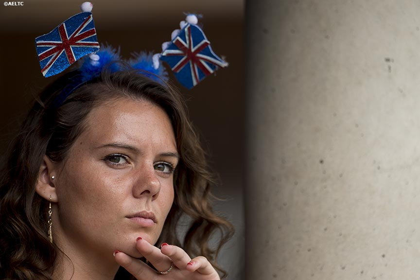 """A fan wears a British flag headband as she watches a match at the All England Lawn and Tennis Club in London, England Monday, June 30, 2014 during the 2014 Championships Wimbledon."""