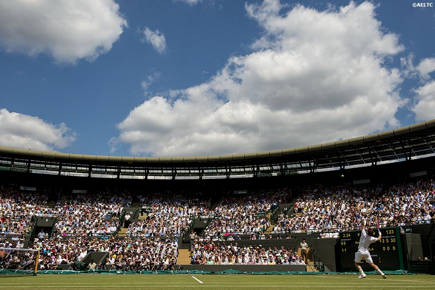 """Andy Murray serves during a match against Blaz Rola on No. 1 Court at the All England Lawn and Tennis Club in London, England Tuesday, June 24, 2014 during the 2014 Championships Wimbledon."""
