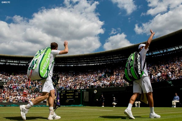 """""""Andy Murray and Blaz Rola wave to the crowd as they exit No. 1 Court at the All England Lawn and Tennis Club in London, England Tuesday, June 24, 2014 during the 2014 Championships Wimbledon."""""""