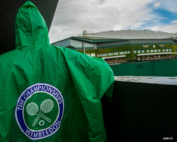 """""""A fan wears a Wimbledon rain coat during a rain delay at the All England Lawn and Tennis Club in London, England Saturday, June 28, 2014 during the 2014 Championships Wimbledon."""""""