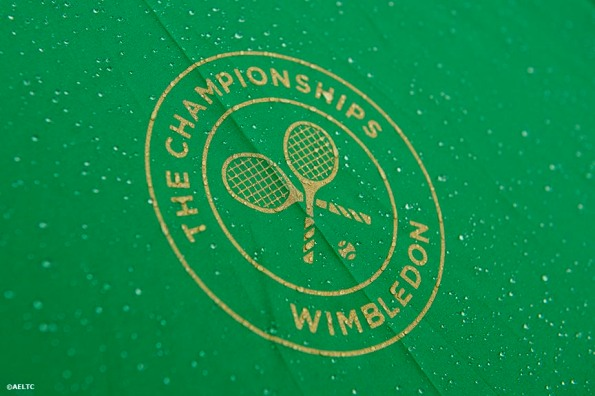 """""""A logo on a Wimbledon umbrella is shown during a rain delay at the All England Lawn and Tennis Club in London, England Saturday, June 28, 2014 during the 2014 Championships Wimbledon."""""""