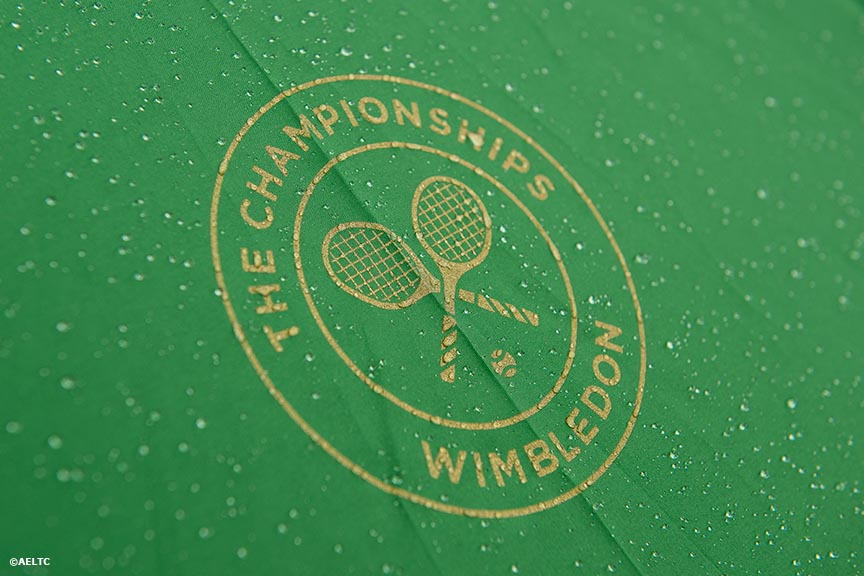 """A logo on a Wimbledon umbrella is shown during a rain delay at the All England Lawn and Tennis Club in London, England Saturday, June 28, 2014 during the 2014 Championships Wimbledon."""