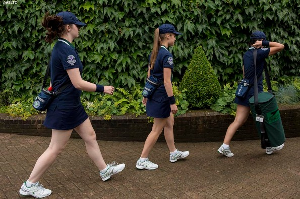 """""""Ball girls walk toward No. 18 Court after a rain delay at the All England Lawn and Tennis Club in London, England Saturday, June 28, 2014 during the 2014 Championships Wimbledon."""""""