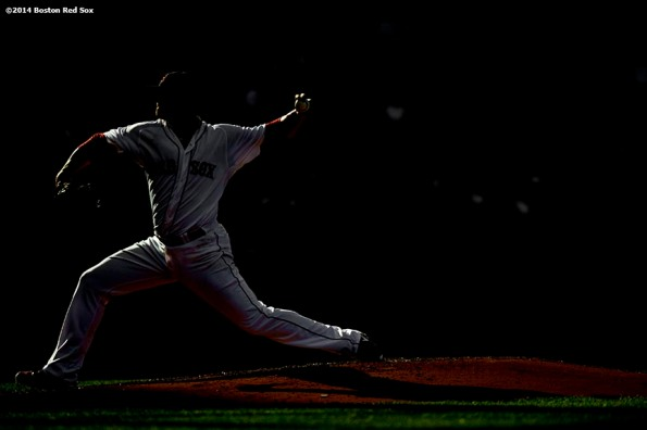 """""""Boston Red Sox pitcher Jon Lester delivers during the sixth inning of a game against the Chicago White Sox Thursday, July 10, 2014 at Fenway Park in Boston, Massachusetts."""""""