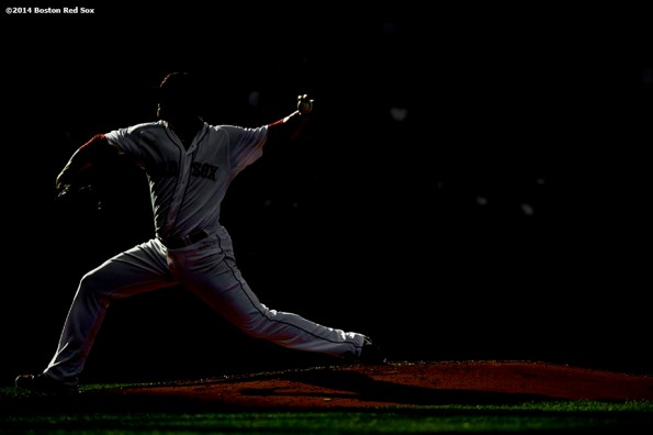 """Boston Red Sox pitcher Jon Lester delivers during the sixth inning of a game against the Chicago White Sox Thursday, July 10, 2014 at Fenway Park in Boston, Massachusetts."""