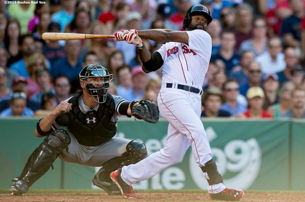 """""""Boston Red Sox center fielder Jackie Bradley Jr. hits a double during the sixth inning of a game against the Chicago White Sox Thursday, July 10, 2014 at Fenway Park in Boston, Massachusetts."""""""