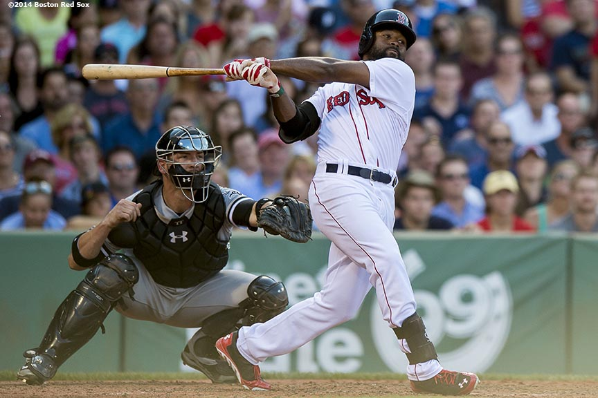 """Boston Red Sox center fielder Jackie Bradley Jr. hits a double during the sixth inning of a game against the Chicago White Sox Thursday, July 10, 2014 at Fenway Park in Boston, Massachusetts."""