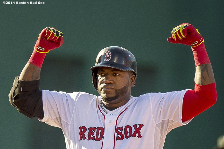 """""""Boston Red Sox designated hitter David Ortiz flexes his muscles at second base after hitting an RBI double during the sixth inning of a game against the Chicago White Sox Thursday, July 10, 2014 at Fenway Park in Boston, Massachusetts."""""""