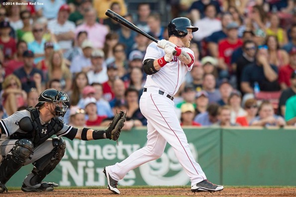 """""""Boston Red Sox pinch hitter Mike Carp hits a game winning walk-off double during the tenth inning to defeat the Chicago White Sox 4-3 Thursday, July 10, 2014 at Fenway Park in Boston, Massachusetts."""""""