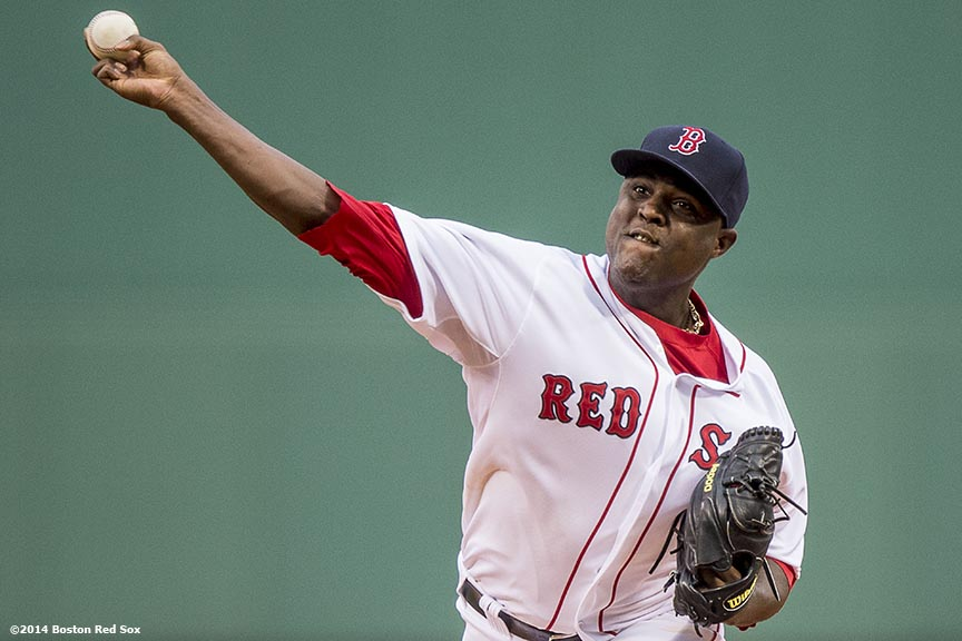 """""""Boston Red Sox pitcher Rubby De La Rosa delivers during the first inning of a game against the Kansas City Royals Saturday, July 19, 2014 at Fenway Park in Boston, Massachusetts. """""""
