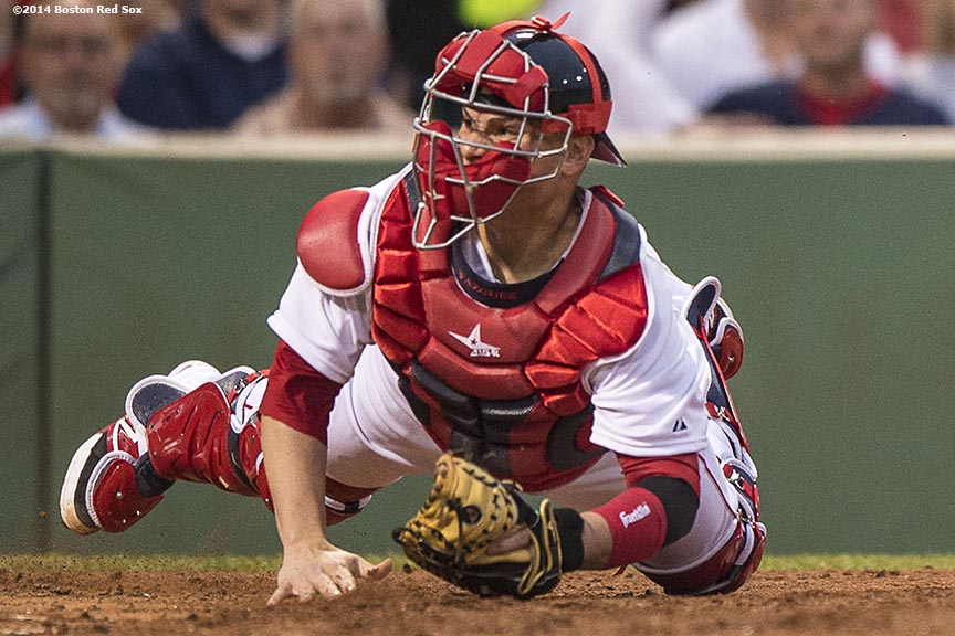 """Boston Red Sox catcher Christian Vazquez misses a tag on center fielder Jarrod Dyson as he scores during the third inning of a game against the Kansas City Royals Saturday, July 19, 2014 at Fenway Park in Boston, Massachusetts. """