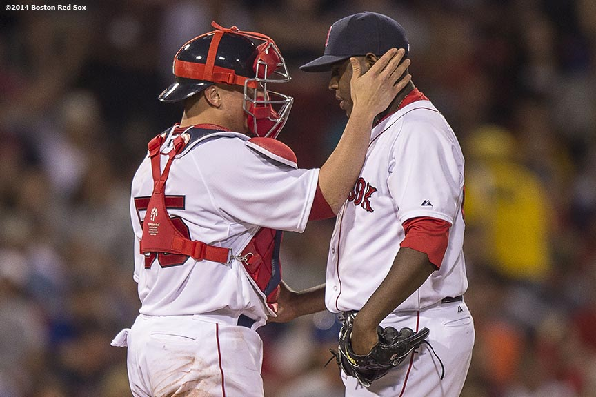 """""""Boston Red Sox catcher Christian Vazquez chats with pitcher Rubby De La Rosa during a mound visit during the sixth inning of a game against the Kansas City Royals Saturday, July 19, 2014 at Fenway Park in Boston, Massachusetts. """""""