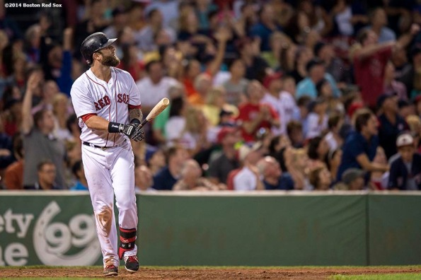 """Boston Red Sox first baseman Mike Napoli hits a go-ahead solo home run during the sixth inning of a game against the Kansas City Royals Saturday, July 19, 2014 at Fenway Park in Boston, Massachusetts. """