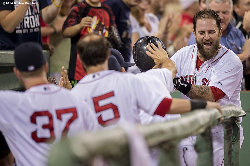 """Boston Red Sox first baseman Mike Napoli reacts as he is congratulated by teammates after hitting a go-ahead solo home run during the sixth inning of a game against the Kansas City Royals Saturday, July 19, 2014 at Fenway Park in Boston, Massachusetts. """