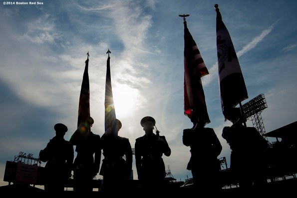 """Members of the military color guards are introduced during the fifth annual Run to Home Base presented by New Balance at Fenway Park in Boston, Massachusetts Saturday, July 19, 2014."""