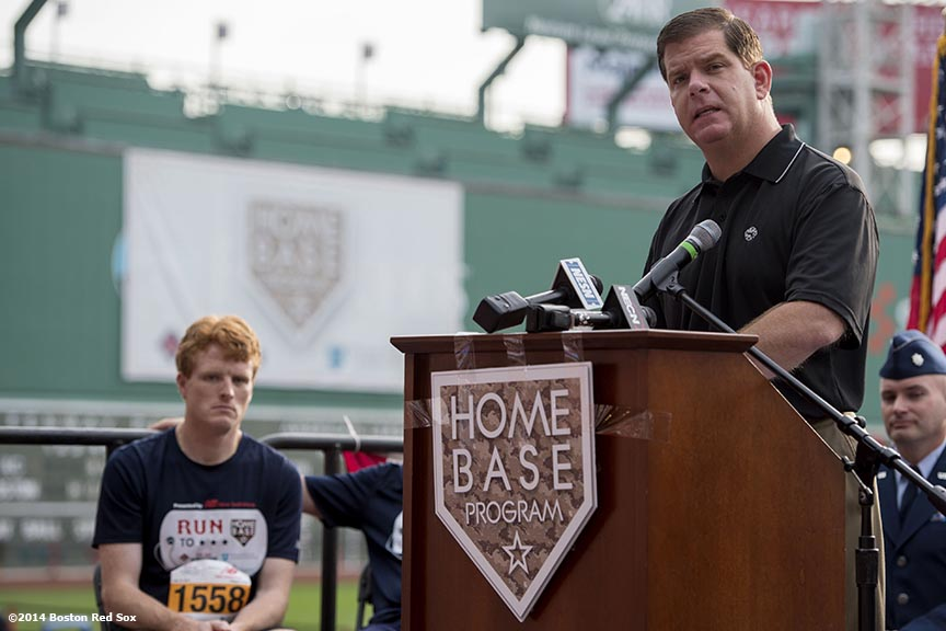 """Boston Mayor Marty Walsh gives remarks during the fifth annual Run to Home Base presented by New Balance at Fenway Park in Boston, Massachusetts Saturday, July 19, 2014."""