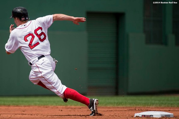 """Boston Red Sox third baseman Brock Holt rounds second base as he advances on a single by left fielder Daniel Nava during the first inning of a game against the Kansas City Royals Sunday, July 20, 2014 at Fenway Park in Boston, Massachusetts. """