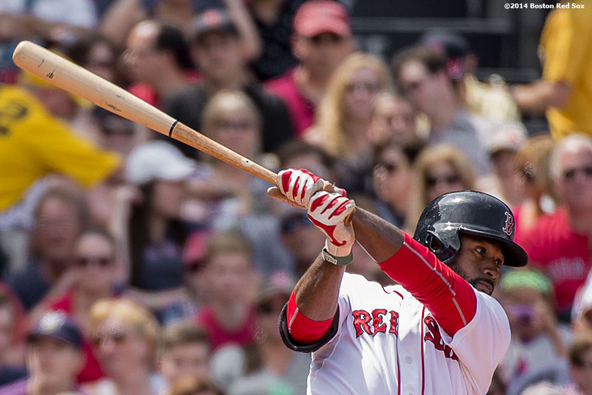 """Boston Red Sox center fielder Jackie Bradley Jr. hits a single during the third inning of a game against the Kansas City Royals Sunday, July 20, 2014 at Fenway Park in Boston, Massachusetts. """