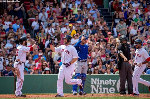 """Boston Red Sox second baseman Dustin Pedroia high fives catcher David Ross and Jackie Bradley Jr. as they cross the plate after scoring on a ground rule double by right fielder Daniel Nava during the third inning of a game against the Kansas City Royals Sunday, July 20, 2014 at Fenway Park in Boston, Massachusetts. """