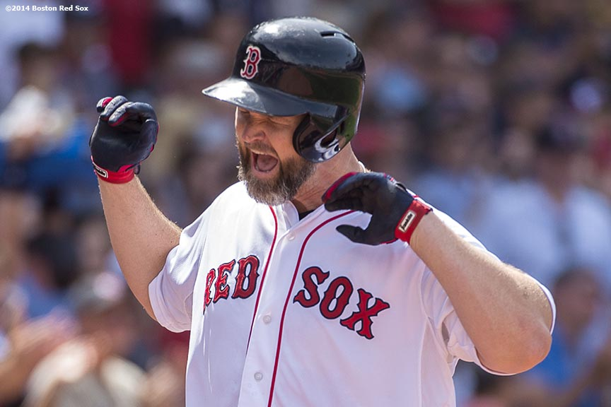 """""""Boston Red Sox catcher David Ross reacts after hitting a two run home run during the fourth inning of a game against the Kansas City Royals Sunday, July 20, 2014 at Fenway Park in Boston, Massachusetts. """""""