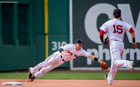 """Boston Red Sox shortstop Stephen Drew dives as he fields a ground ball to start a double play with second baseman Dustin Pedroia during the eighth inning of a game against the Kansas City Royals Sunday, July 20, 2014 at Fenway Park in Boston, Massachusetts. """