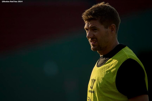 """Liverpool FC midfielder Steven Gerrard warms up during an open practice session before a match against AS Roma during Football at Fenway at Fenway Park in Boston, Massachusetts Tuesday, July 23, 2014. """