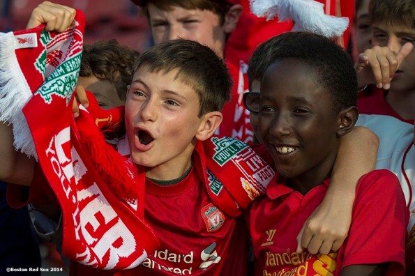 """Young Liverpool FC fans cheer during an open practice session before a match against AS Roma during Football at Fenway at Fenway Park in Boston, Massachusetts Tuesday, July 23, 2014. """