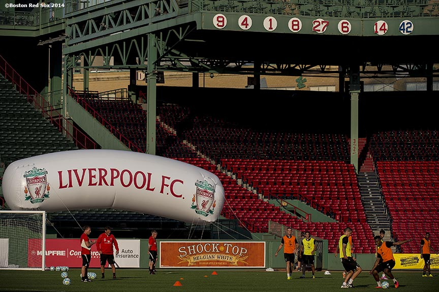 """Members of Liverpool FC warm up during an open practice session before a match against AS Roma during Football at Fenway at Fenway Park in Boston, Massachusetts Tuesday, July 23, 2014."""