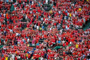 """Liverpool FC fans cheer during a match between Liverpool FC and AS Roma during Football at Fenway at Fenway Park in Boston, Massachusetts Wednesday, July 23, 2014. """