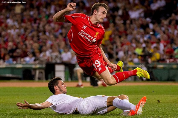 """""""Liverpool FC defender Jack Robinson trips over a defender in the second half of a match against AS Roma during Football at Fenway at Fenway Park in Boston, Massachusetts Wednesday, July 23, 2014. """""""