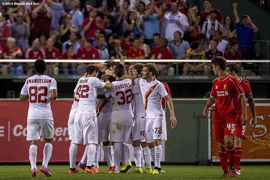 """Members of AS Roma celebrate after scoring the game-winning goal against Liverpool FC during Football at Fenway at Fenway Park in Boston, Massachusetts Wednesday, July 23, 2014. """