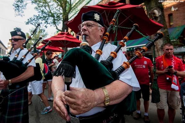 """""""Members of the Sutherland Pipe Band play bagpipes on Yawkey Way before a match between Liverpool FC and AS Roma during Football at Fenway at Fenway Park in Boston, Massachusetts Wednesday, July 23, 2014. """""""