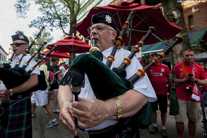 """Members of the Sutherland Pipe Band play bagpipes on Yawkey Way before a match between Liverpool FC and AS Roma during Football at Fenway at Fenway Park in Boston, Massachusetts Wednesday, July 23, 2014. """