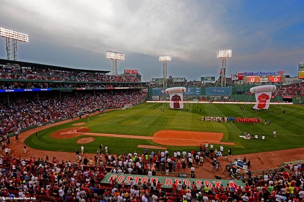 """Starting lineups are introduced before a match between Liverpool FC and AS Roma during Football at Fenway at Fenway Park in Boston, Massachusetts Wednesday, July 23, 2014. """