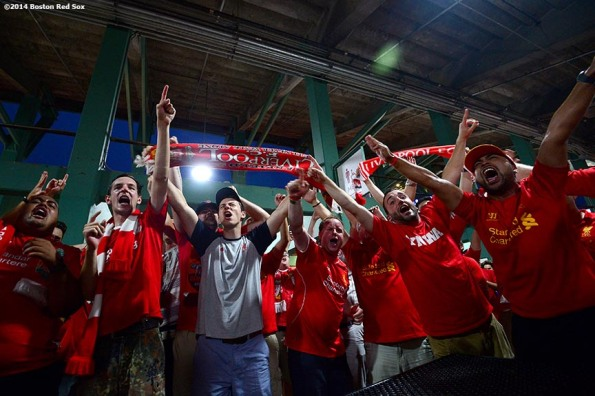 """""""Liverpool FC fans cheer in the big concourse during halftime of a match between Liverpool FC and AS Roma during Football at Fenway at Fenway Park in Boston, Massachusetts Wednesday, July 23, 2014. """""""