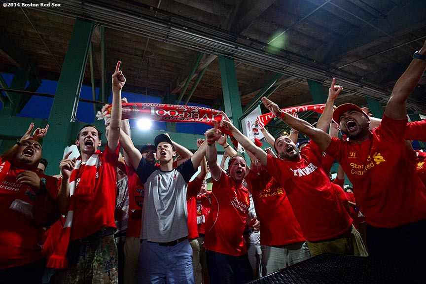 """Liverpool FC fans cheer in the big concourse during halftime of a match between Liverpool FC and AS Roma during Football at Fenway at Fenway Park in Boston, Massachusetts Wednesday, July 23, 2014. """