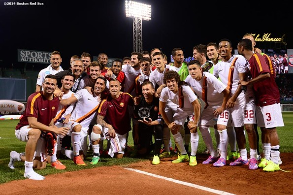 """AS Roma poses for a team photograph with the Buick Champion's trophy after defeating Liverpool FC 1-0 during Football at Fenway at Fenway Park in Boston, Massachusetts Wednesday, July 23, 2014. """