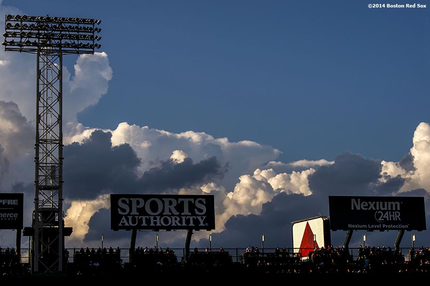 """""""Clouds form over the Green Monster during a game between the Boston Red Sox and the Toronto Blue Jays at Fenway Park in Boston, Massachusetts Monday, July 28, 2014."""""""