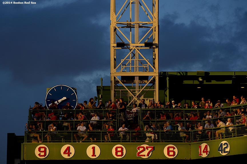 """""""Clouds form over the retired numbers on the Budweiser Deck during a game between the Boston Red Sox and the Toronto Blue Jays at Fenway Park in Boston, Massachusetts Monday, July 28, 2014."""""""