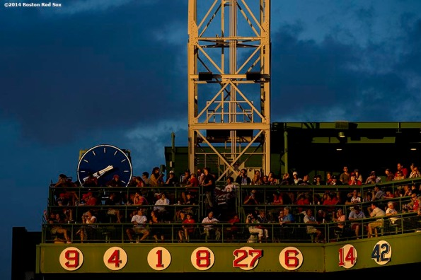 """Clouds form over the retired numbers on the Budweiser Deck during a game between the Boston Red Sox and the Toronto Blue Jays at Fenway Park in Boston, Massachusetts Monday, July 28, 2014."""
