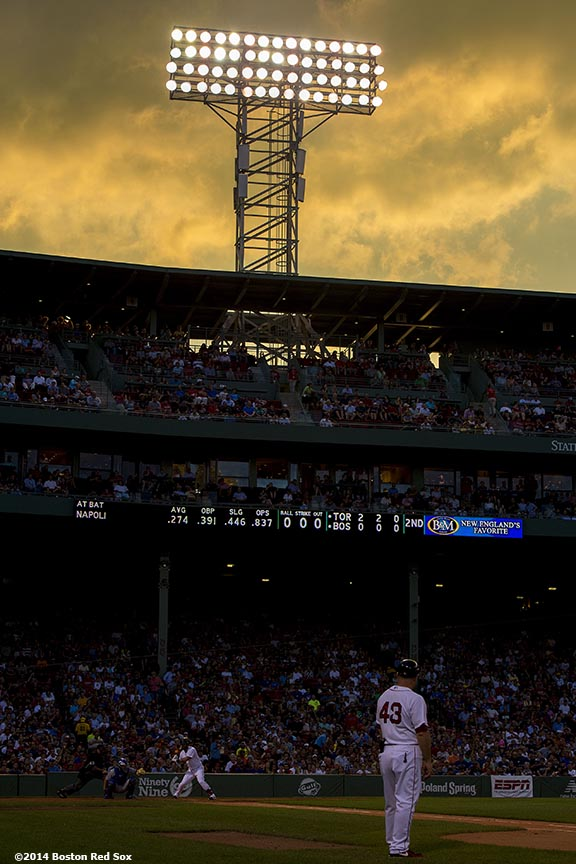 """Clouds form during a game between the Boston Red Sox and the Toronto Blue Jays at Fenway Park in Boston, Massachusetts Monday, July 28, 2014."""