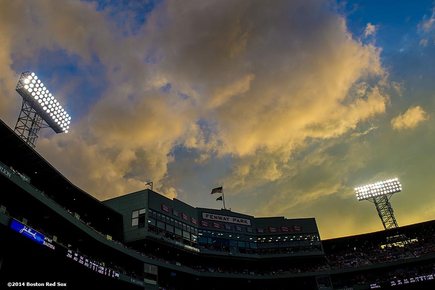"""""""Clouds form during a game between the Boston Red Sox and the Toronto Blue Jays at Fenway Park in Boston, Massachusetts Monday, July 28, 2014."""""""
