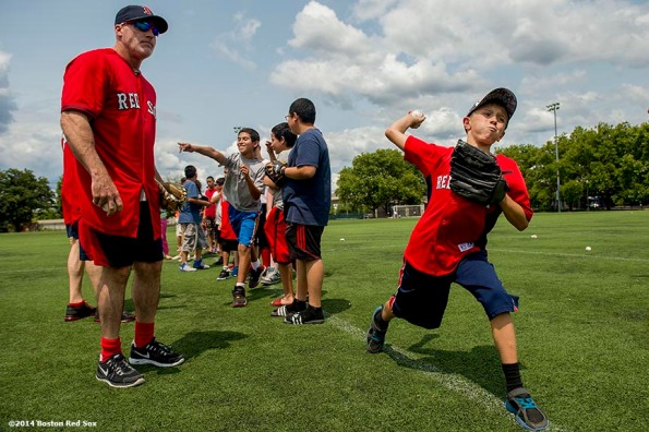 """Boston Red Sox bullpen coach Dana Levangie watches as a participant pitches during a Sox Talk baseball clinic at Satori Field in East Boston, Massachusetts Wednesday, July 30, 2014."""