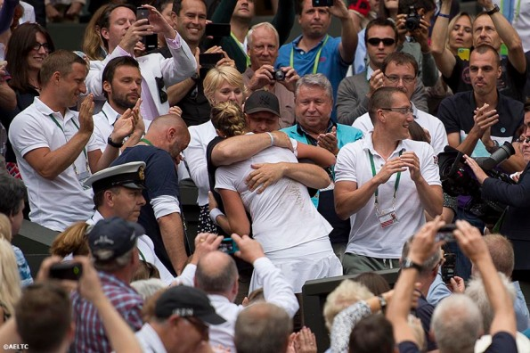 """Petra Kvitova hugs members of her team in the players' box after winning the ladies' singles final against Eugenie Bouchard on Centre Court at the All England Lawn and Tennis Club in London, England Saturday, July 5, 2014 during the 2014 Championships Wimbledon."""