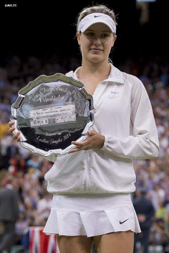 """Petra Kvitova poses for a photograph as she holds the Venus Rosewater Dish after winning the ladies' singles final against Eugenie Bouchard on Centre Court at the All England Lawn and Tennis Club in London, England Saturday, July 5, 2014 during the 2014 Championships Wimbledon."""